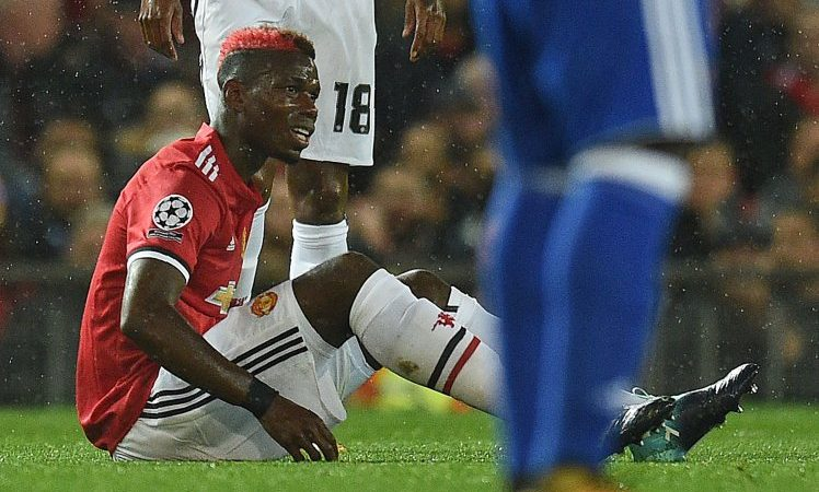 Manchester United's French midfielder Paul Pogba reacts following a challenge during the UEFA Champions League Group A football match between Manchester United and Basel at Old Trafford in Manchester, north west England on September 12, 2017. / AFP PHOTO / Oli SCARFFOLI SCARFF/AFP/Getty Images