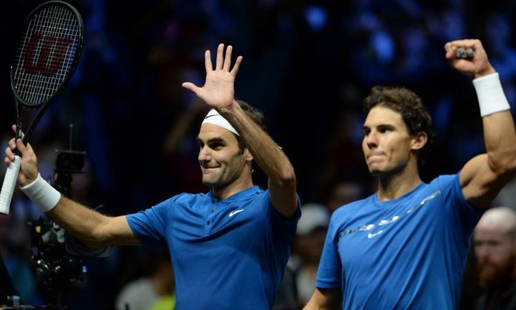 Switzerland's Roger Federer of Team Europe and his teammate Spain's Rafael Nadal celebrate their victory over team World's Sam Querrey and Jack Sock during the second day of Laver Cup on September 23, 2017 in O2 Arena, in Prague.  / AFP PHOTO / Michal Cizek        (Photo credit should read MICHAL CIZEK/AFP/Getty Images)