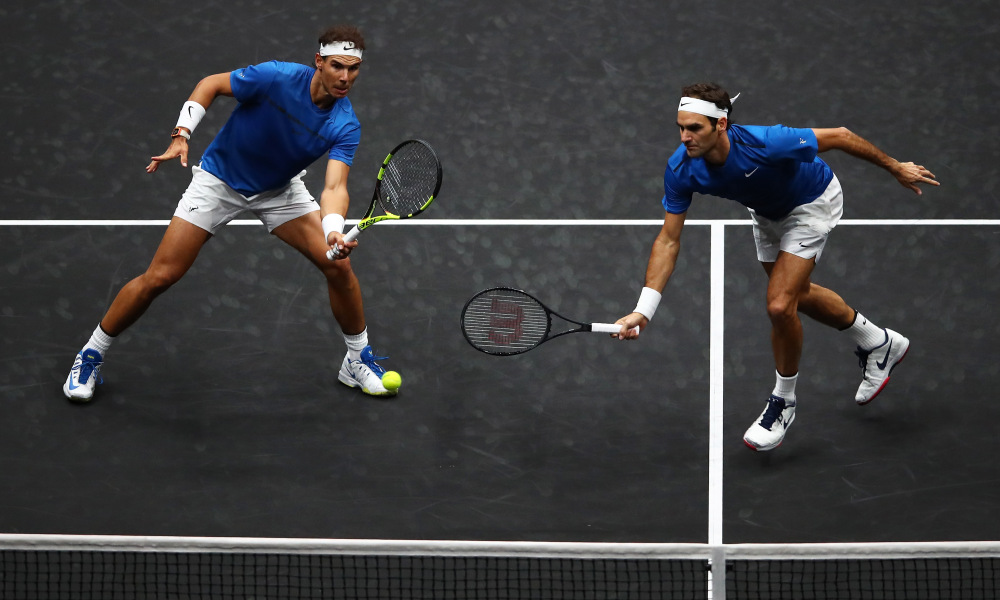 PRAGUE, CZECH REPUBLIC - SEPTEMBER 23:  Roger Federer and Rafael Nadal of Team Europe in action during there doubles match against Jack Sock and Sam Querrey of Team World on Day 2 of the Laver Cup on September 23, 2017 in Prague, Czech Republic. The Laver Cup consists of six European players competing against their counterparts from the rest of the World. Europe will be captained by Bjorn Borg and John McEnroe will captain the Rest of the World team. The event runs from 22-24 September.  (Photo by Clive Brunskill/Getty Images for Laver Cup) ORG XMIT: 775043754 ORIG FILE ID: 852500634